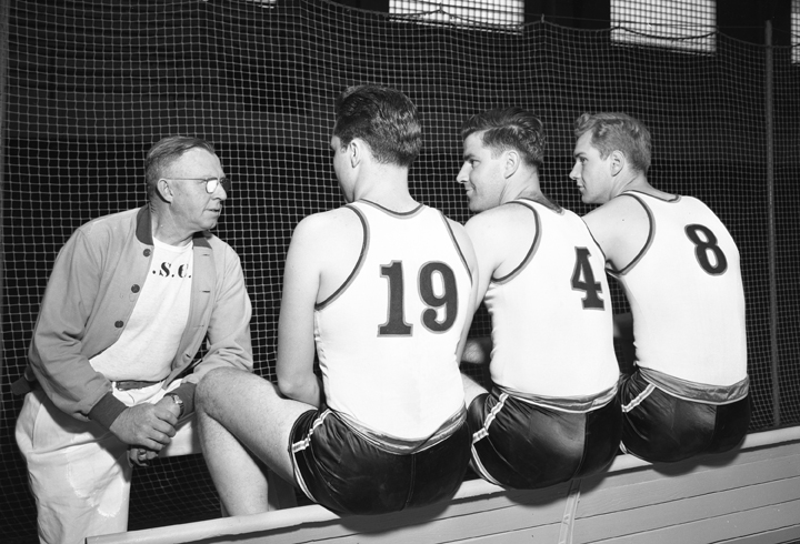 On the Banks of the Red Cedar| Coach talking with Basketball