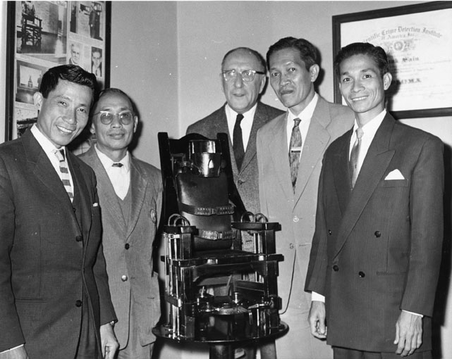 Photograph of Vietnamese Participants in the United States - Major Lam Quang Phong of the Civil Guard, Nguyen Van Huong of the Police Training School, Sheriff Frank G. Sain of Cook County, and Messrs. Vuong Van Ve and Le Van Bay.