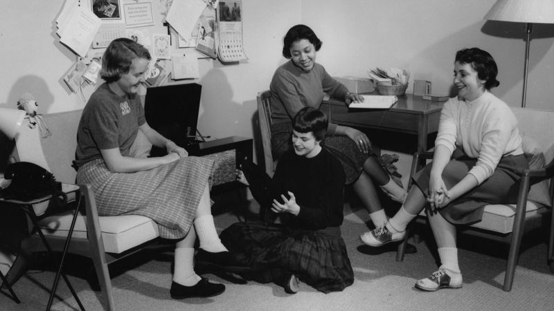 Students in a Dorm Room ( 1958). Four women gather around a record player in their dorm room.